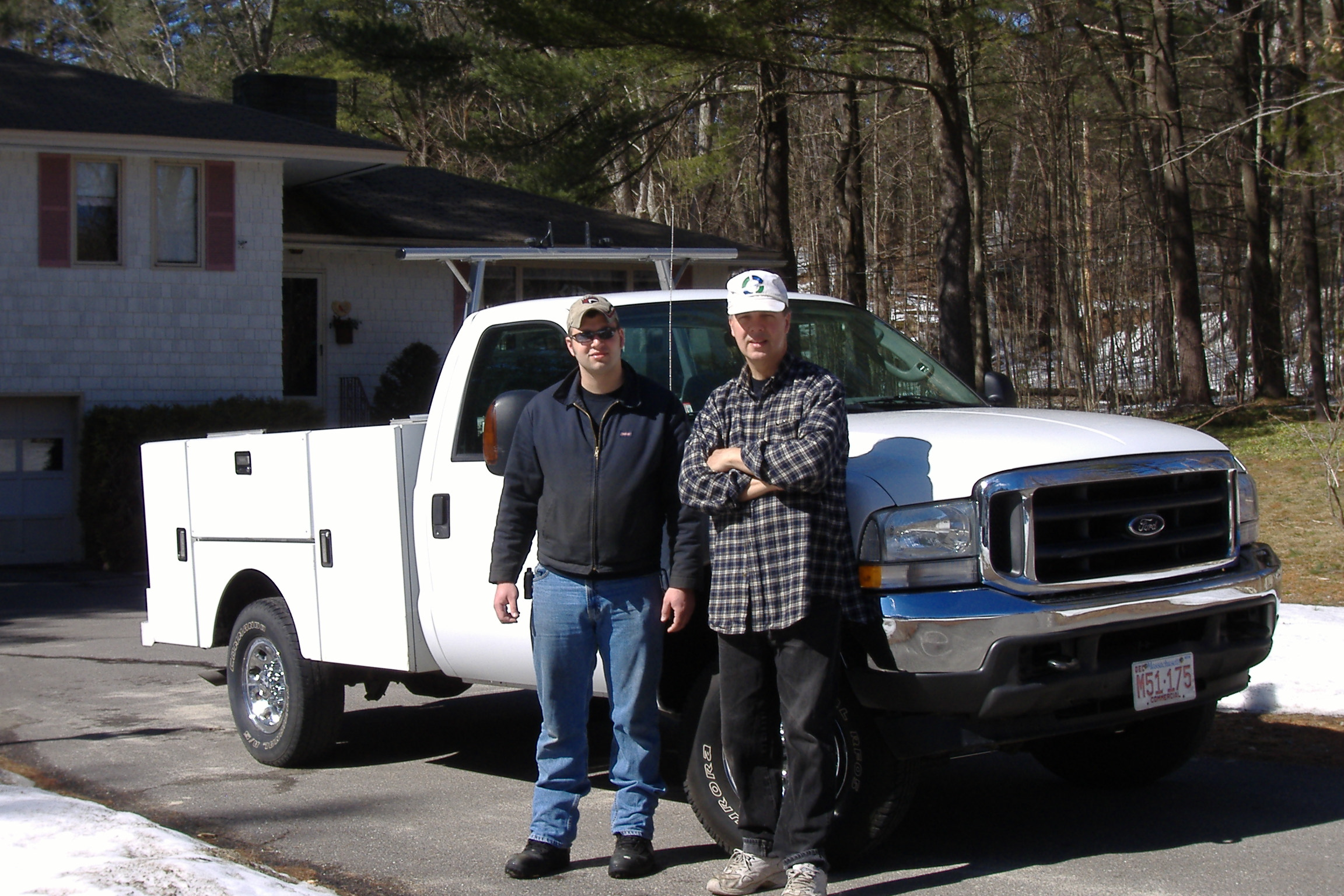 Greg and Paul infront of Power Equipment Maintenance and Repair truck